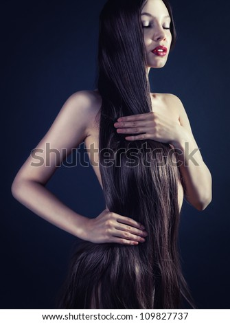 Image of a young woman with long hair and eyes closed - stock photo
