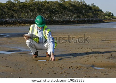 Image of an ecologist out in the field, within a city rivers eco system - stock photo