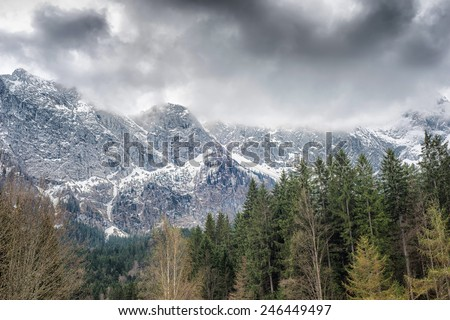 Image of an imminent storm brewing over a mountain range - stock photo
