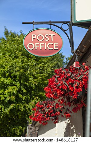 Image of an old fashioned post office sign in a rural location.  - stock photo