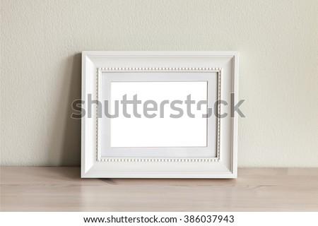 Image of an ornate white frame mockup scene. - stock photo