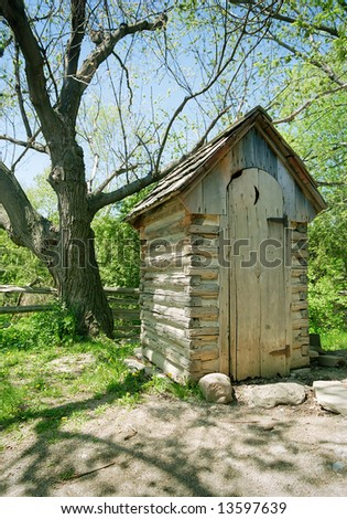 Image of an outhouse or outdoor toilet in the country.  Scanned from film negative. - stock photo