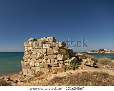 Image of ancient ruins by the beach near the village of Side in Turkey. - stock photo