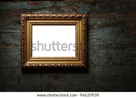 Image of antique picture frame on old wood texture - stock photo