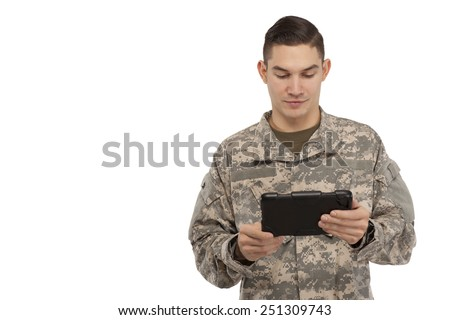 Image of army soldier using digital tablet against white background - stock photo