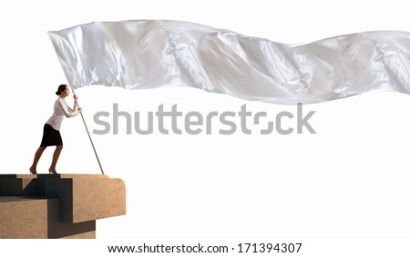 Image of attractive businesswoman holding white flag. Place for text - stock photo