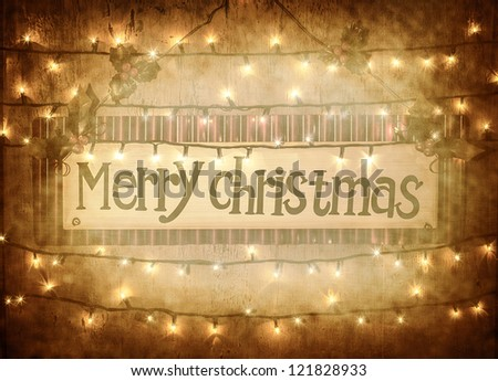 Image of banner with text of Merry Christmas on grungy background, glowing garland, electrical yellow lights, happy Christmastime holidays, abstract shiny backdrop, festive greeting postcard - stock photo