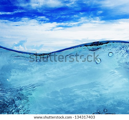 Image of beautiful blue sunny sky with clouds reflected in the water - stock photo