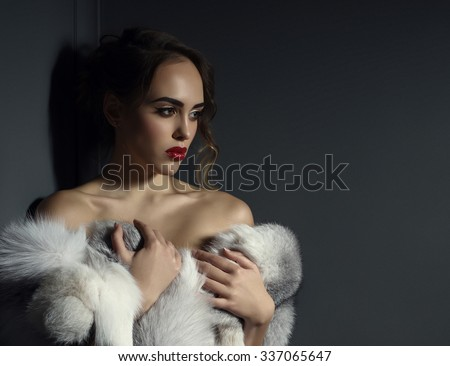 Image of beautiful model posing naked with fur - stock photo
