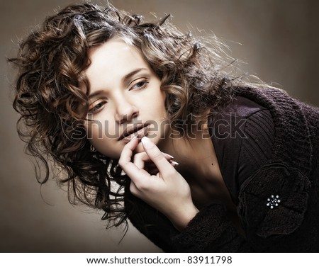 Image of beautiful young woman with curly hair - stock photo