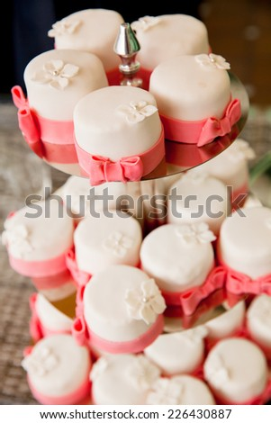 Image of beautifully decorated wedding cupcakes on a plate - stock photo