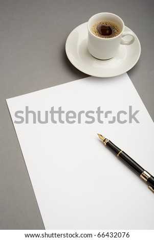 Image of blank paper sheet with penholder on workplace with cup of coffee near by - stock photo