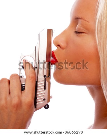 Image of blonde girl kisses a pistol - stock photo