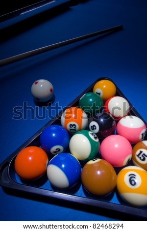 Image of blue billiard table with all the balls in triangle shape - stock photo
