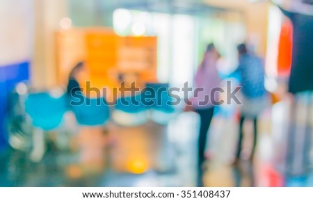 image of blur people in office for background usage . - stock photo