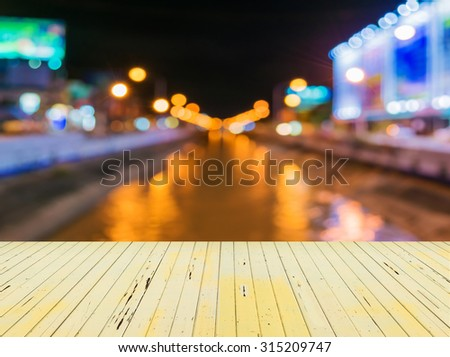 image of blur street and canel  bokeh  in night time with warm colorful lights for background usage . - stock photo