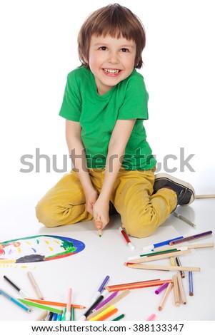 Image of boy doodling, on white background - stock photo