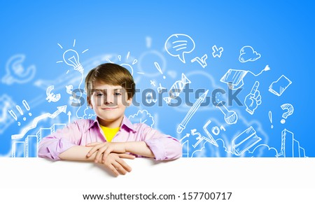 Image of boy holding blank white banner. Place for text - stock photo