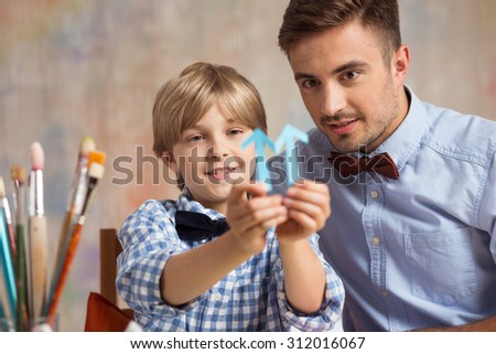 Image of boy improving his art skills during private lessons - stock photo