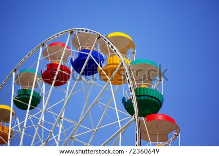 Image of bright colored carousel. - stock photo