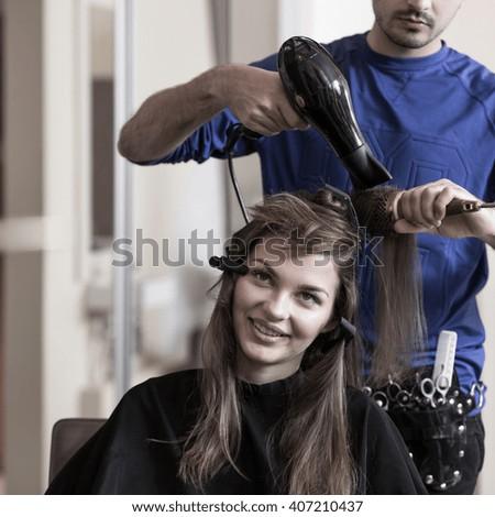 Image of brunette girl at hairdresser salon - stock photo