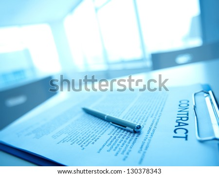 Image of business contract and pen on table - stock photo