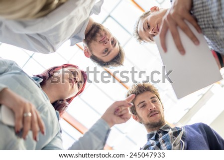 Image of business friends discussing brainstorming and ideas at meeting inside beautiful modern building place - stock photo