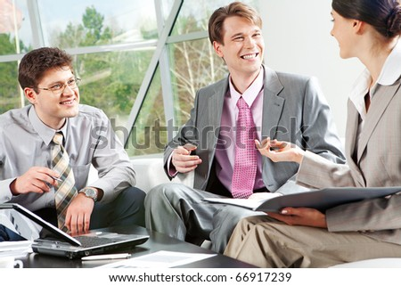 Image of business group discussing a their work - stock photo