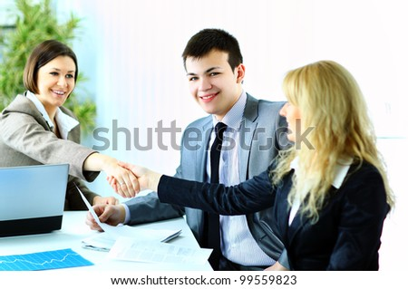 Image of business handshake after making an agreement in modern office - stock photo