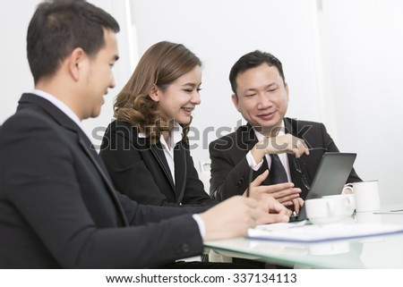 Image of business partners discussing documents and ideas at meeting,asian business team. - stock photo