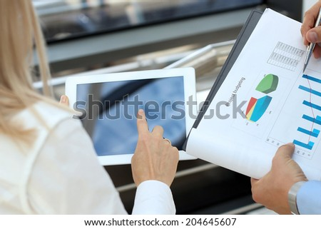 Image of business partners discussing documents and ideas in the office - stock photo