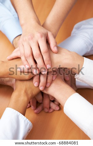 Image of business partners hands on top of each other symbolizing companionship - stock photo