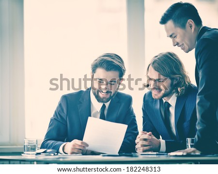 Image of business partners reading the report  - stock photo