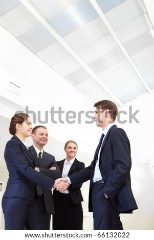 Image of business people handshaking after signing agreement - stock photo