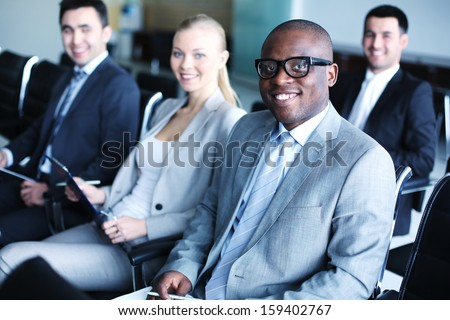 Image of business people sitting in rows at conference - stock photo