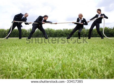 Image of business people standing in the stadium and playing - stock photo
