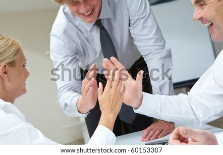 Image of business people with their palms opposite each other symbolizing support - stock photo
