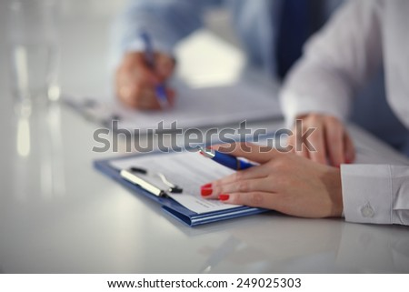 Image of business t eam sitting at the table and discussing a new project - stock photo