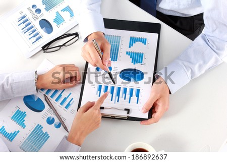 Image of business team at the meeting discussing chart - stock photo