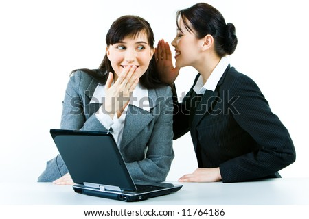 Image of business woman telling a secret to another - stock photo