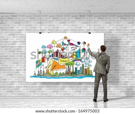 Image of businessman drawing business plan on white banner - stock photo