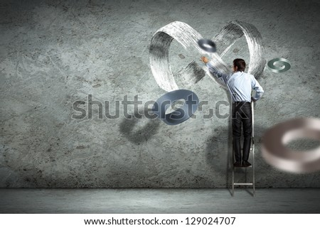 Image of businessman drawing infinity sign on wall - stock photo