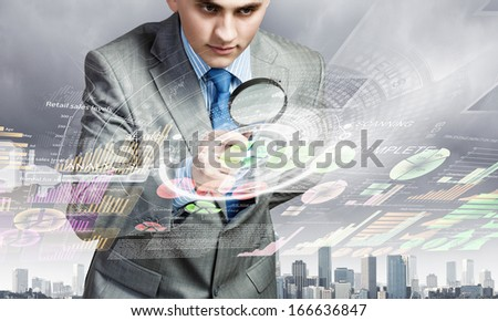 Image of businessman examining objects with magnifier - stock photo