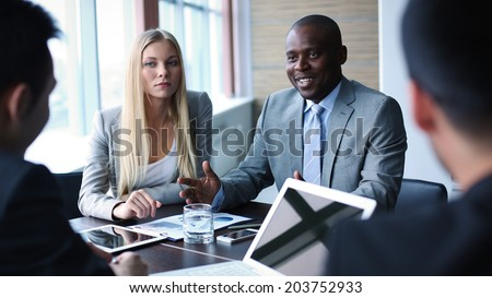 Image of businessman explaining his point of view to colleagues at meeting - stock photo