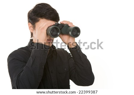Image of businessman in black shirt holding binoculars - stock photo