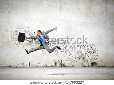 Image of businessman in jump against sketch background - stock photo