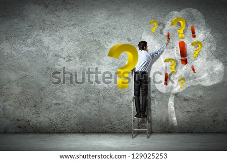 Image of businessman standing on ladder against question signs - stock photo