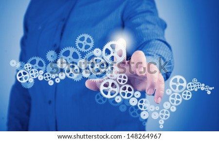 Image of businessman touching gear elements. Mechanism concept - stock photo