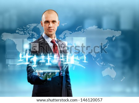 Image of businessman with tablet pc against high-tech background - stock photo