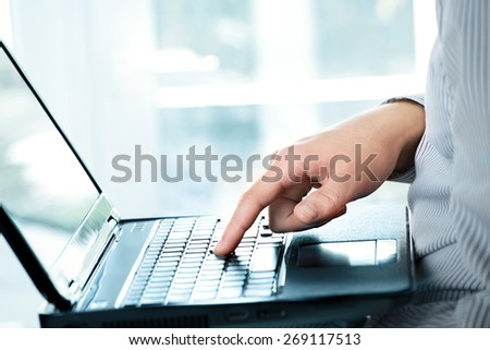 Image of businessman working on laptop - stock photo